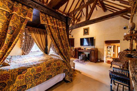 Wood, Lighting, Room, Interior design, Bed, Textile, Floor, Hardwood, Ceiling, Linens,