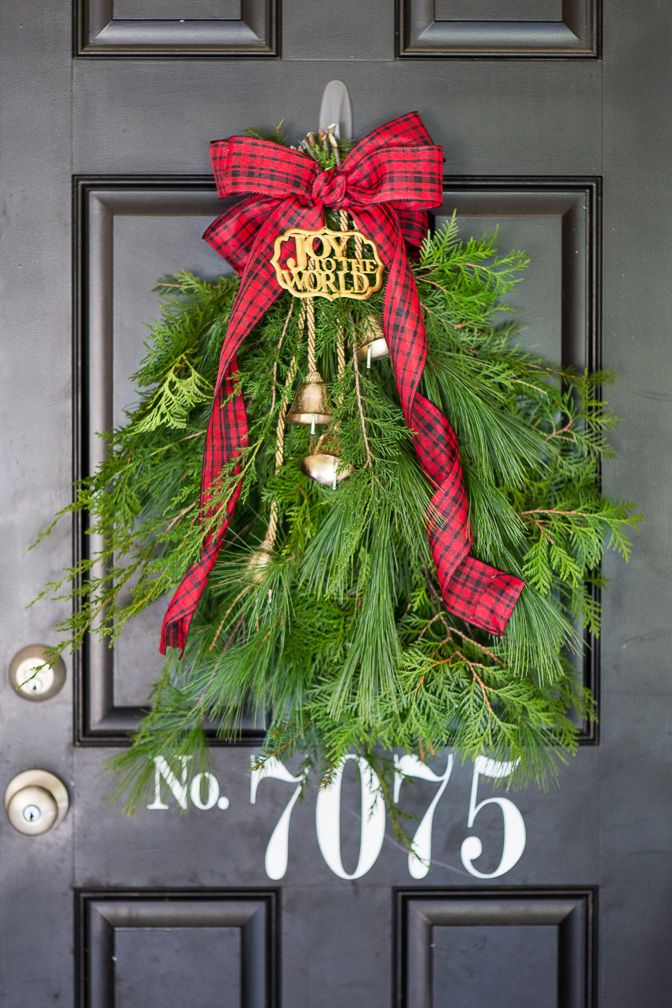 ribbon and bell christmas swag door decoration