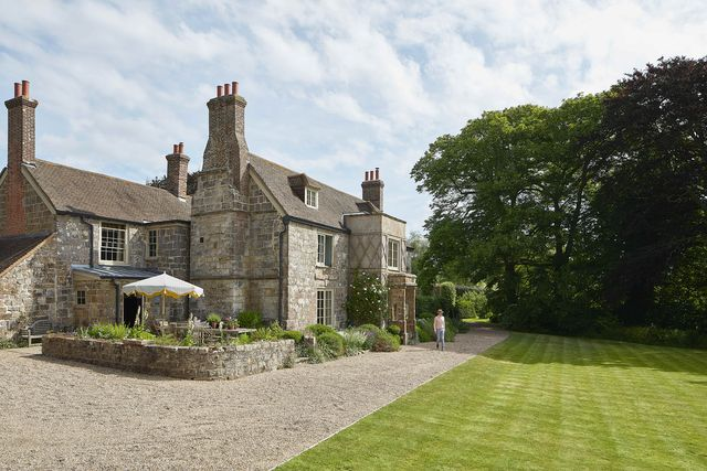 the sussex sandstone farmhouse dates to the 17th century, with porches and casement windows added around 1805