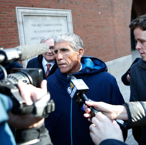 rick singer exiting a courthouse