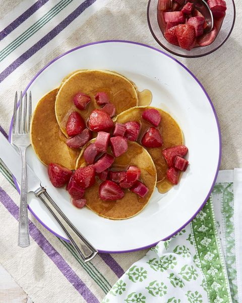 ricotta pancakes topped with strawberries and rhubarb