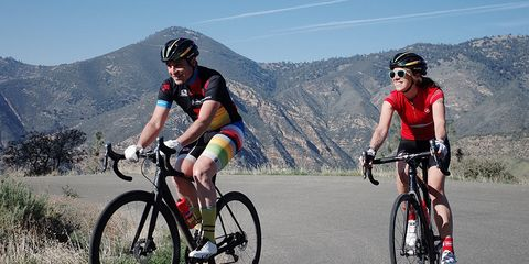Editor-in-Chief Bill Strickland and Cait Giddings riding road bikes in California.