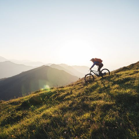 riding downhill in the mountains at sunset