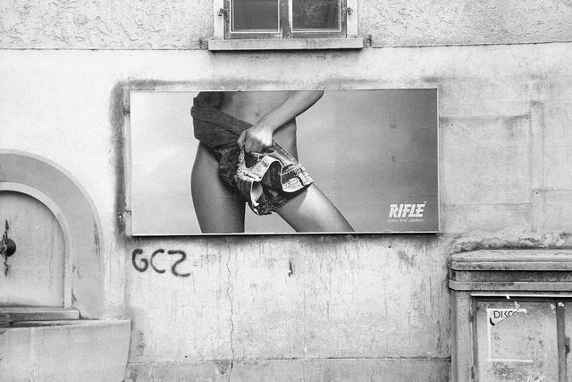 rifle jeans poster ad on an outside wall, 1985