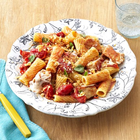 Rigatoni in floral bowl with blue napkin