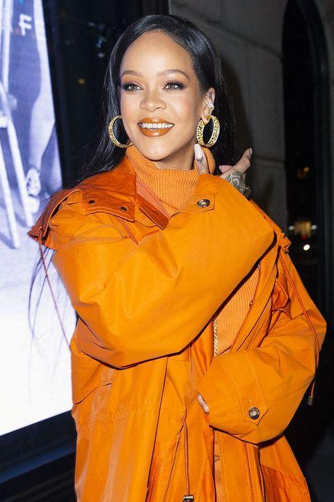 Orange, Yellow, Fashion, Fashion design, Outerwear, Smile, Performance,