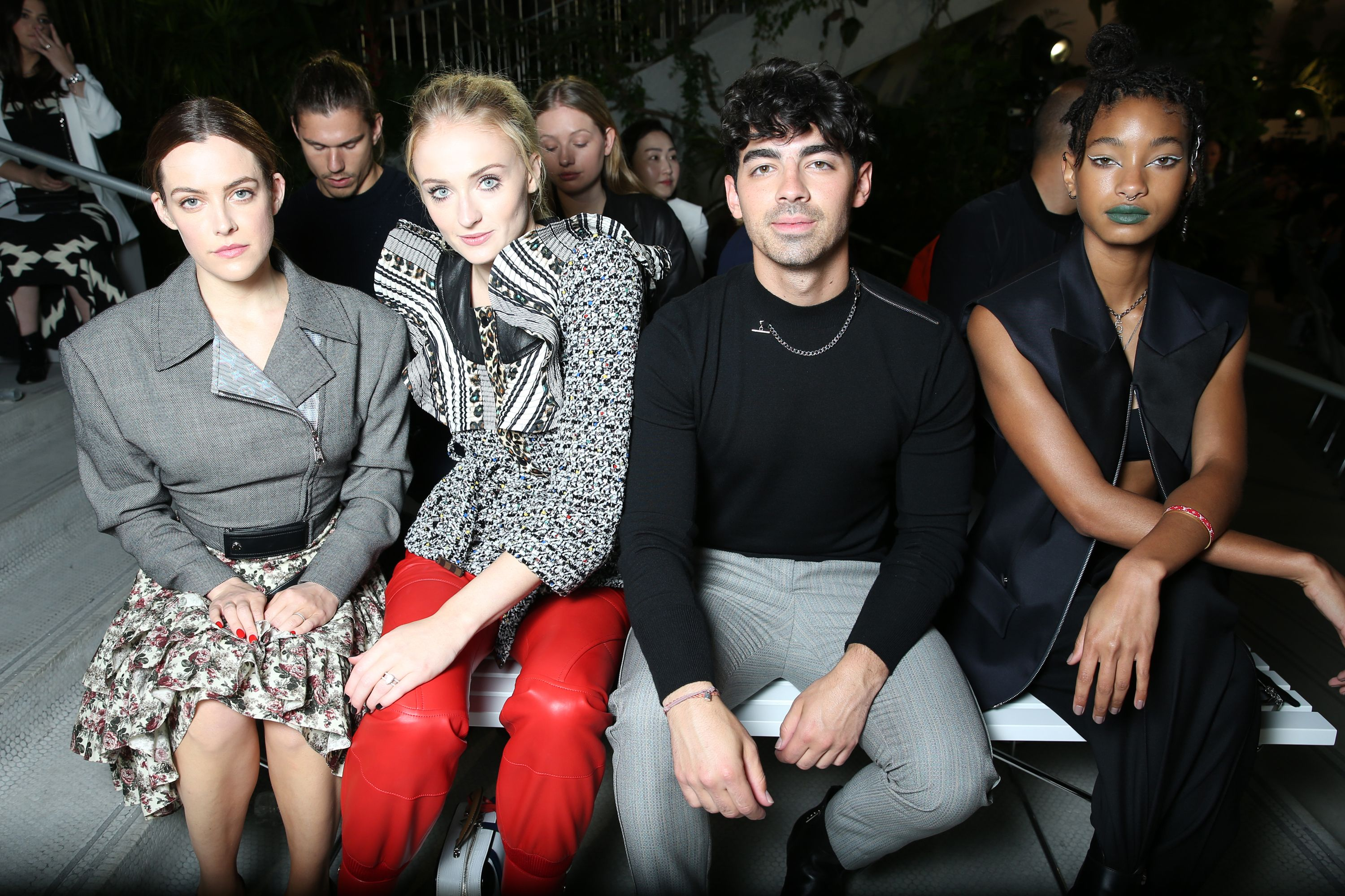 Riley Keough, Sophie Turner, Joe Jonas, and Willow Smith in the front row.