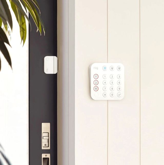 ring home security system keypad on side of home