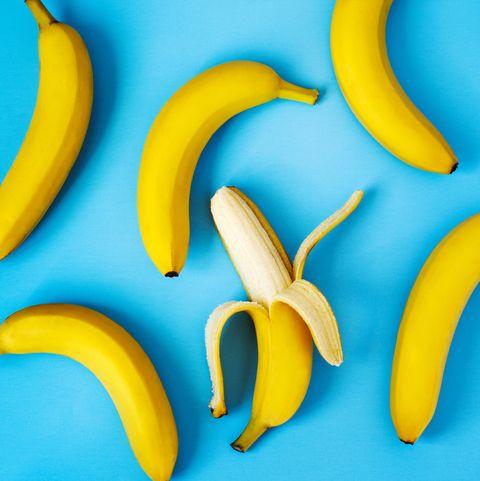 ripe bananas on blue background