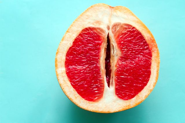 ripe juicy grapefruit  isolated on a blue background