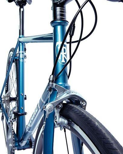 Bicycle, Bicycle part, Bicycle wheel, Bicycle frame, Bicycle handlebar, Hybrid bicycle, Vehicle, Bicycle fork, Blue, Bicycle accessory,