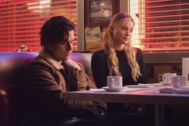 """riverdale    """"chapter eighty one the homecoming""""    image number rvd505b0235r    pictured l r cole sprouse as jughead jones and lili reinhart as betty cooper    photo dean buscherthe cw    © 2021 the cw network, llc all rights reserved"""
