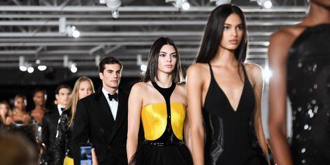 Fashion model, Fashion, Yellow, Model, Little black dress, Dress, Suit, Event, Formal wear, Fashion design,