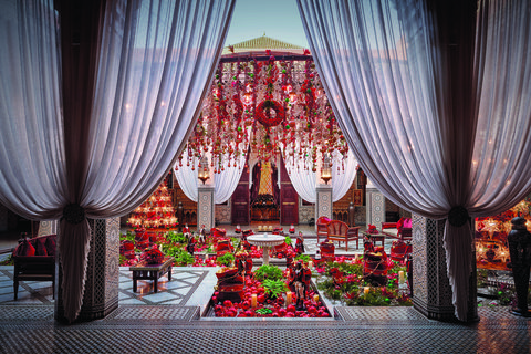 Decoration, Curtain, Red, Interior design, Floral design, Textile, Room, Wedding reception, Ceremony, Floristry,