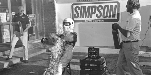 indianapolis, in   may 31 bill simpson, founder of simpson safety equipment, demonstrates the effectiveness of his fire suit after practice for the indianapolis 500 usac indy car race at the indianapolis motor speedway in indianapolis, indiana, on may 31, 1986 photo by bob harmeyerarchive photosgetty images