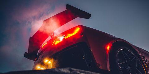 Geological phenomenon, Heat, Sky, Vehicle, Automotive lighting, Luxury vehicle, Fire, Car, Flame, Auto part,