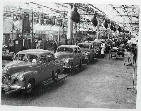 """the first all australian motor, the """"holden,"""" is in mass production at the rate of 20,000 a year by general motors holdens ltd here are holden sedans coming off the production line at fishermen's bend plant production is undertaken at both fishermen's bend victoria and woodville south australia  location fishermen's bend, victoria, australia"""