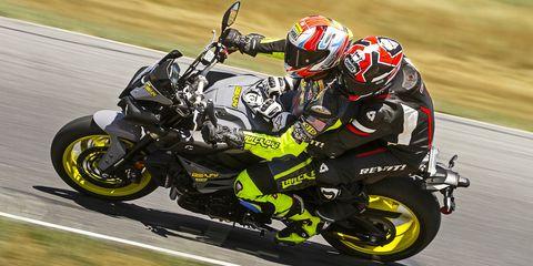 Land vehicle, Vehicle, Motorcycle, Superbike racing, Motorsport, Motorcycle racer, Road racing, Race track, Racing, Motorcycling,