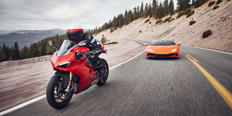 Land vehicle, Vehicle, Motorcycle, Car, Automotive design, Superbike racing, Mountain range, Automotive exterior, Motorcycling, Road,