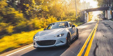 Land vehicle, Vehicle, Car, Performance car, Automotive design, Yellow, Sports car, Rim, Automotive exterior, Wheel,