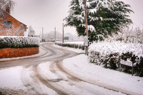 A road covered in snow in a rural Welsh village