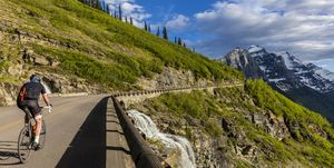 Road cycling on Going to the Sun Road, Glacier National Park, Montana, USA