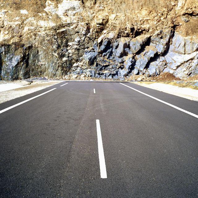 road ending at rugged rockface