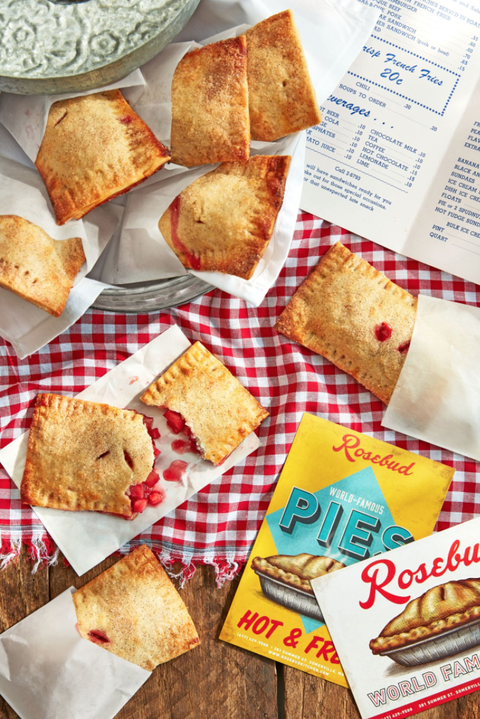 a shot of cherry hand pies inspired by roadside stands shot on a red gingham tablecloth