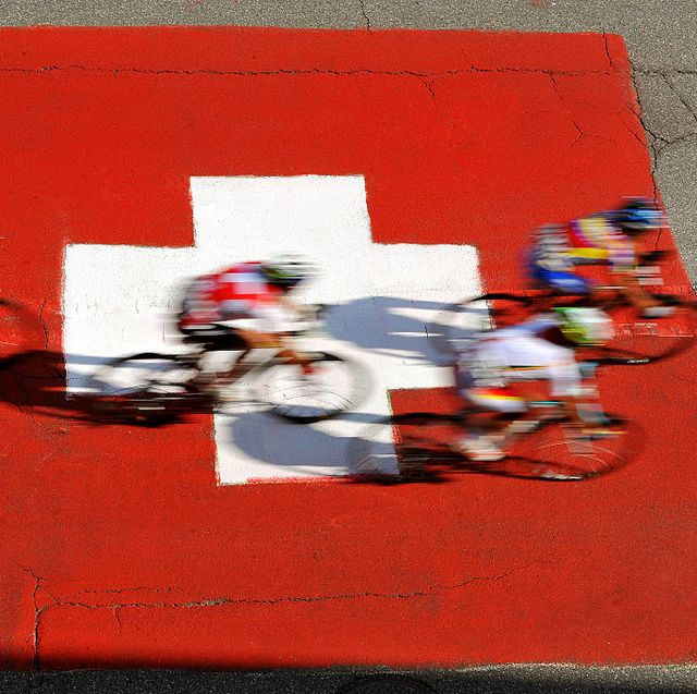 uci road world championships   road men's elite cyclists passing over painted swiss flag on road