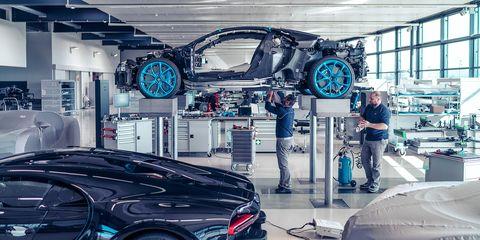 Motor vehicle, Automotive design, Vehicle, Car, Automobile repair shop, Supercar, Performance car, Sports car, Machine, Building,