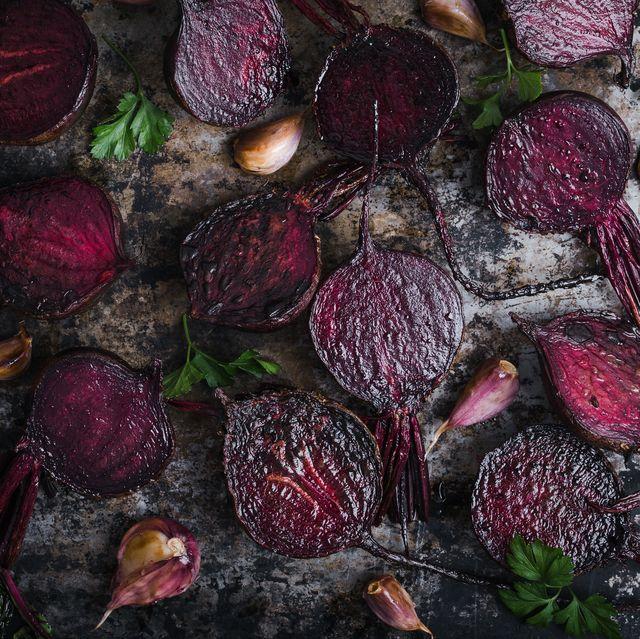 roasted beetroots and garlic on baking sheet