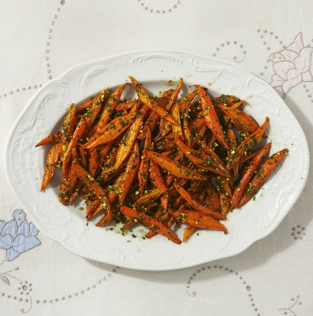 roasted carrots with spring pesto on white platter