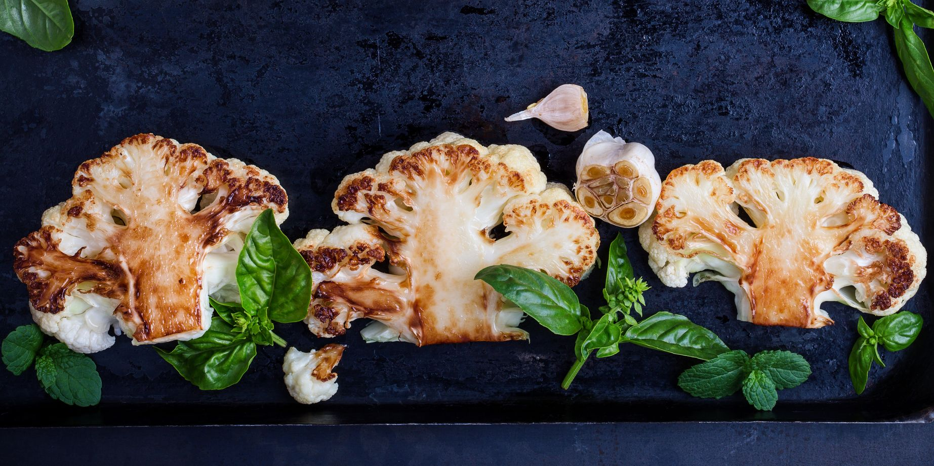 Roasted organic cauliflower steak on baking dish