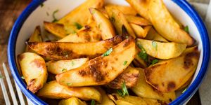 Roasted potato wedges in dinner bowl