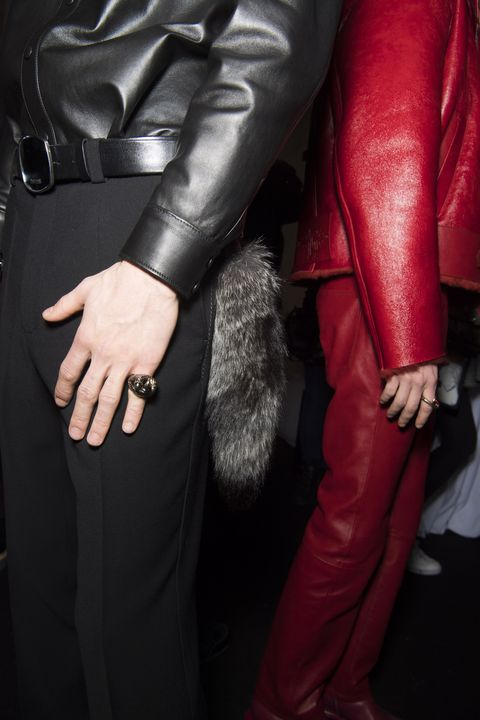 Leather, Red, Leather jacket, Jacket, Hand, Outerwear, Textile, Suit, Finger, Formal wear,
