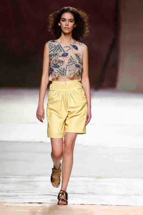 Fashion show, Fashion model, Fashion, Runway, Clothing, Public event, Yellow, Event, Fashion design, Waist,