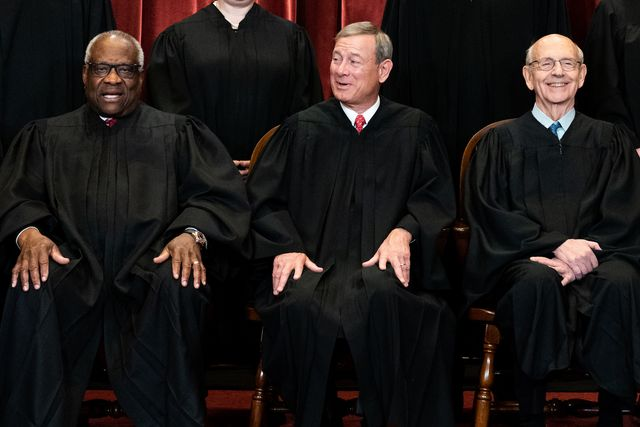 washington, dc   april 23 members of the supreme court pose for a group photo at the supreme court in washington, dc on april 23, 2021 seated from left associate justice clarence thomas, chief justice john roberts and associate justice stephen breyer photo by erin schaff poolgetty images