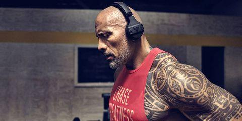 Audio equipment, Facial hair, Tattoo, Muscle, Beard, Vest, Contact sport, Chest, Wrestler, Audio accessory,