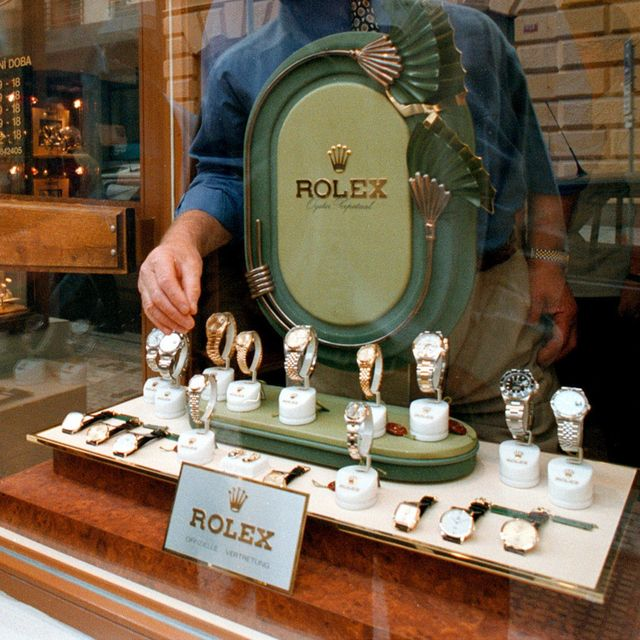 file photo a shop owner gets a rolex out of the front window for a customer in prague september 17, 1998 photo by ami vitale