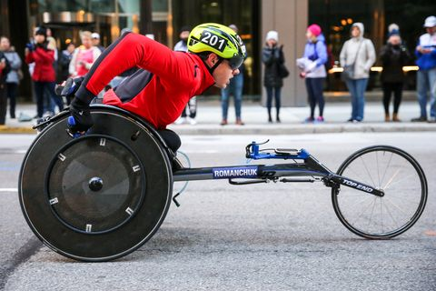 Wheelchair racing, Wheelchair sports, Vehicle, Disabled sports, Wheelchair, Sports, Bicycle wheel, Wheel, Mode of transport, Recreation,