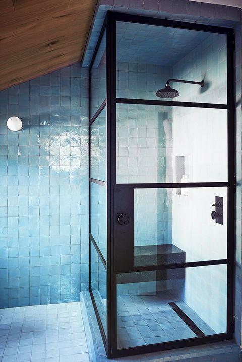 shower with blue tile
