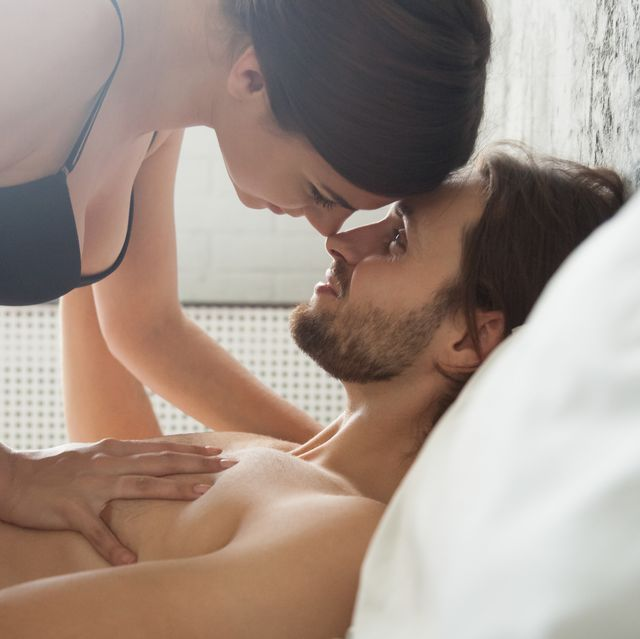 romantic couple enjoy sensual foreplay before sex in bedroom