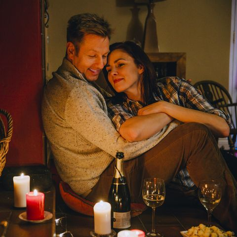 winter date ideas - Romantic Mature Couple Relaxing at Home