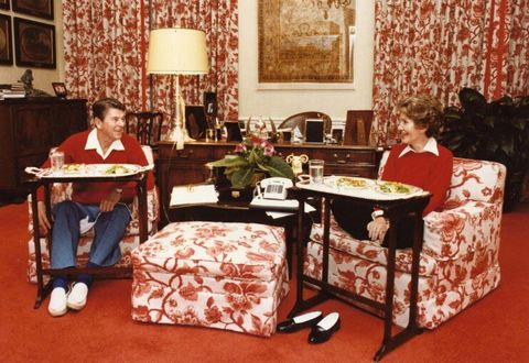 ronald and nancy reagan enjoying a meal on silver tv trays in the white house