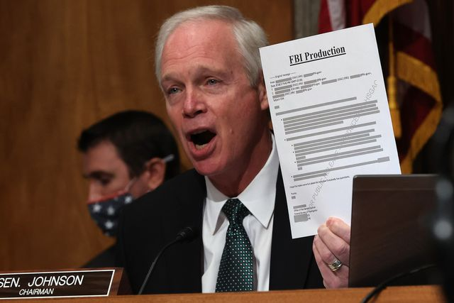washington, dc   december 03 senate homeland security committee chairman ron johnson r wi holds up a redacted document during a hearing about the crossfire hurricane investigation in the dirksen senate office building on capitol hill on december 03, 2020 in washington, dc crossfire hurricane is the code name for the fbi's 2016 counterintelligence investigation into possible links between president donald trump's associates and russian officials a justice department inspector general report found no political bias in the initiation of the investigation, which resulted in the mueller report finding that the trump campaign did not conspire or coordinate with the russian government photo by chip somodevillagetty images