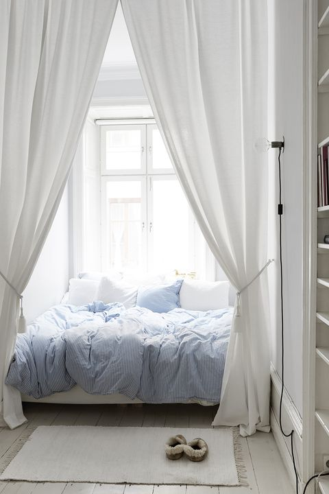 room with blue bedding and canopy