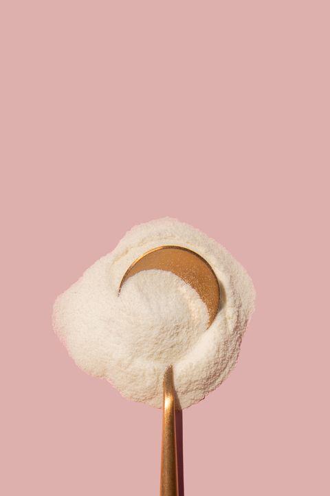 rose gold metallic spoon with powder