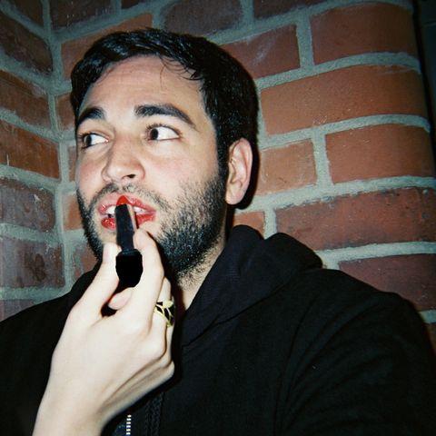 Woman Applying Lipstick To A Man