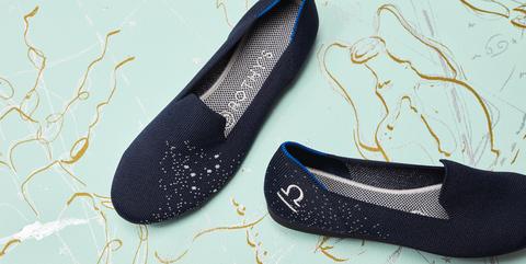 Footwear, Black, Shoe, Ballet flat, Font, Plimsoll shoe, Slipper, Brand, Sneakers,