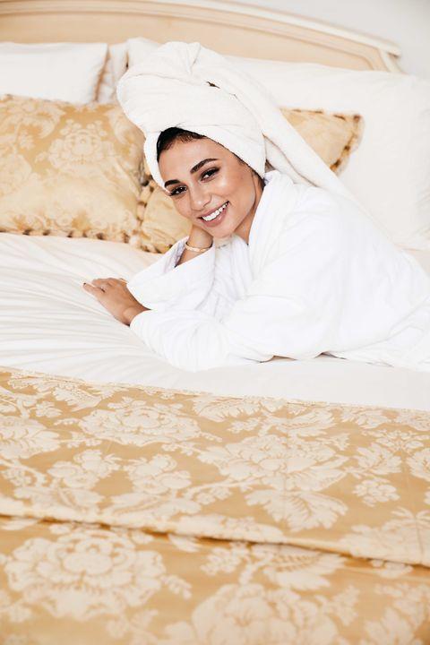 Skin, Room, Dress, Textile, Wedding dress, Bed, Linens, Bride, Tradition, Bridal clothing,
